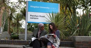 KU students seating outside Penrhyn Road campus reading The River   Photo by: Yuri Cordas