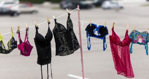 Mandatory Credit: Photo by ZUMA/REX/Shutterstock (4191645f) Bras hang on a line at the Oxmoor Center mall during the 3rd Annual 'Bras Across the Bluegrass' event, a show of support for those affected by breast cancer Bras across the Bluegrass event, Louisville, Kentucky, America - 11 Oct 2014 Nearly 5,000 bras were donated this year during the drive organized by Louisville's 98.9 Radio Now. For each bra, Ashcroft and Oak Jewellers donated one dollar to the National Breast Cancer Foundation, and the bras themselves will be given to a local women's shelter and other deserving charities.