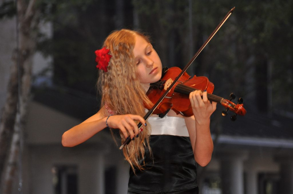 Angela at her violin performance Photo by: Angela Medvedeva