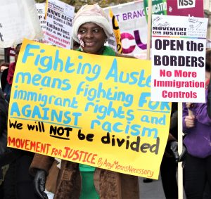 A demonstrator protests against racism Photo: Chanelle FIeld
