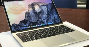 MacBook Pro fully booted to desktop Photo by Dino Groshell