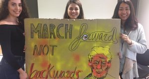 KU Amnesty International members presenting sign for Women's March on London.