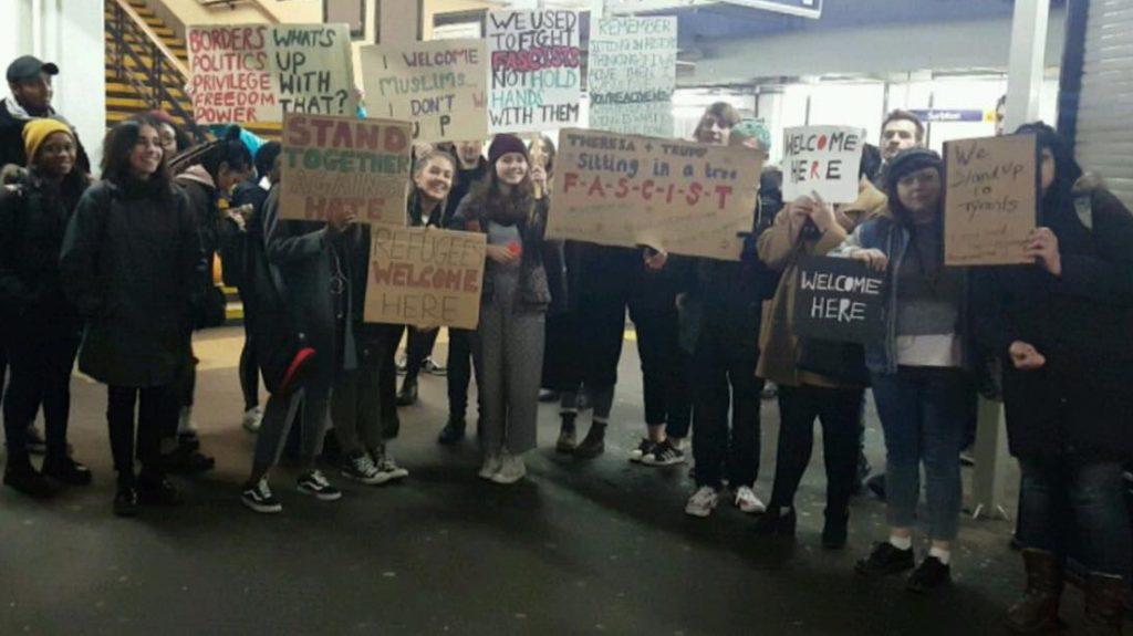 KU Students getting ready to protest the Muslim Ban at Downing Street. Photo credit: Elcin Kaya