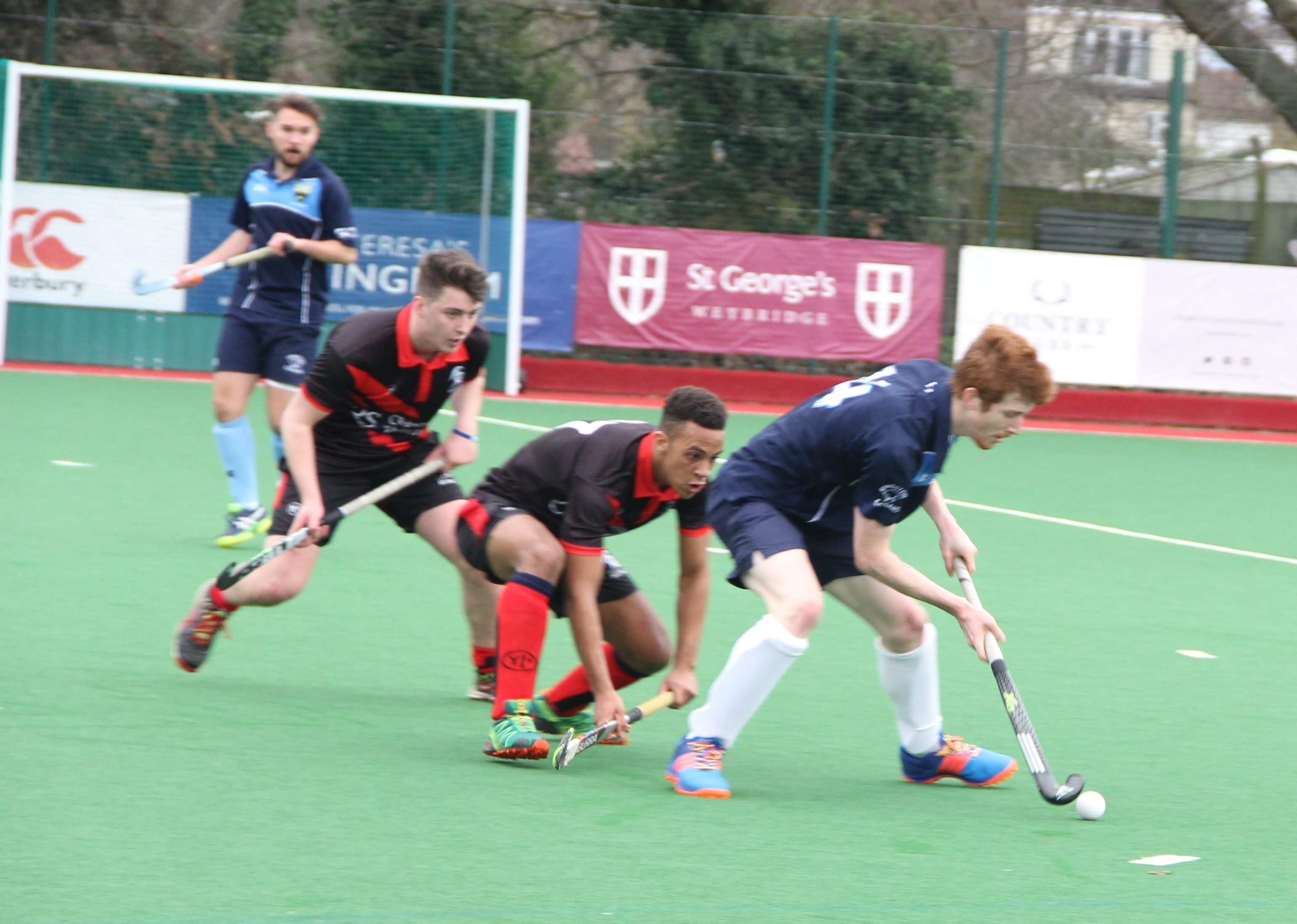 Ben Spencer shielding the ball from defenders Photo: Soile Ntutu
