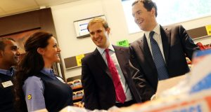 James Berry (left) and George Osborne visit Lidl store in Chessington. Photo Credit: Rex Features