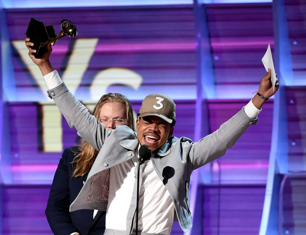 Photo by Frank Micelotta/REX Chance The Rapper accepts his award for best rap album.