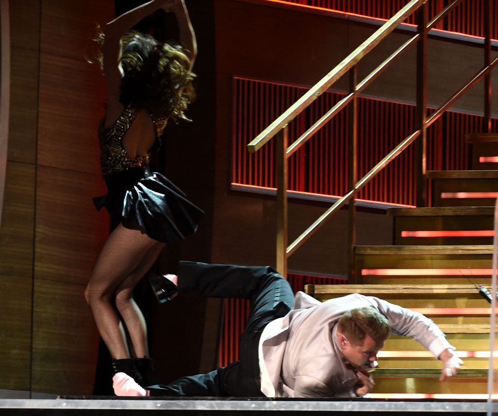 Photo by Frank Micelotta/REX James Corden jokingly fell down the stairs to entertain the crowd.