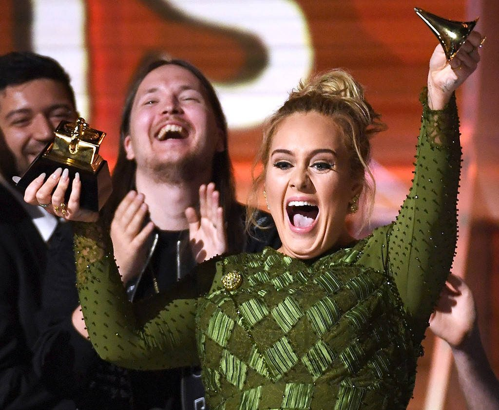 Photo: Kevork Djansezian/Getty Images Adele broke her grammy into to give to Bey after she won best abum of the year.