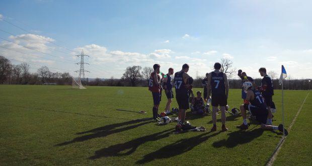 Kingston Mens Lacrosse team at half time