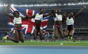 Asha Philip, Desiree Henry, Dina Asher-Smith and Daryll Neita celebrate winning the bronze medal in the women's 4X100 meter relay at the 2016 Summer Olympics in Rio De Janeiro. Photo: Rex Features
