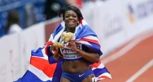 Philip celebrates her gold medal at the European Indoor Championships in Belgrade. Photo: Rex Features