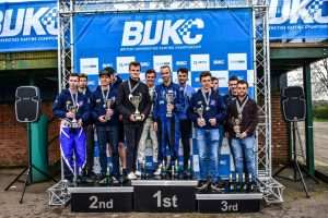 2017 winners Loughborough hold their trophies at the top of the podium. Photo: Karting Magazine