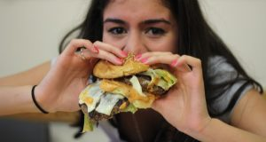 Ria Patel eating the Big Mac.