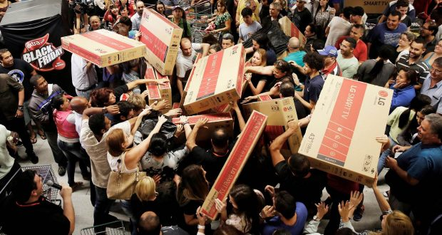 Black Friday shoppers fighting over TVs PHOTO: BUSINESS LEADER MAGAZINE