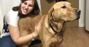Dominika Jesiolowska with her helper dog, Bobby. Photo: Karan Ahluwalia