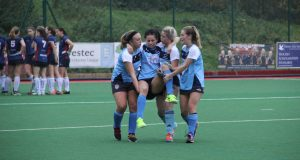 Kingston University womens hockey player being carried off by her team mates after an injury  Photo: Yasemin Kose