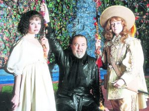 Hall on stage at his production of Twelth Night with actresses: Sara Crow and Maria Miles.