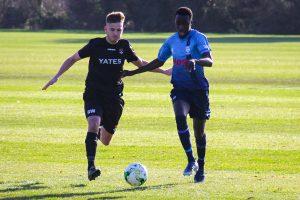Mo Sesay tussles with his marker as he attacks down the right wing