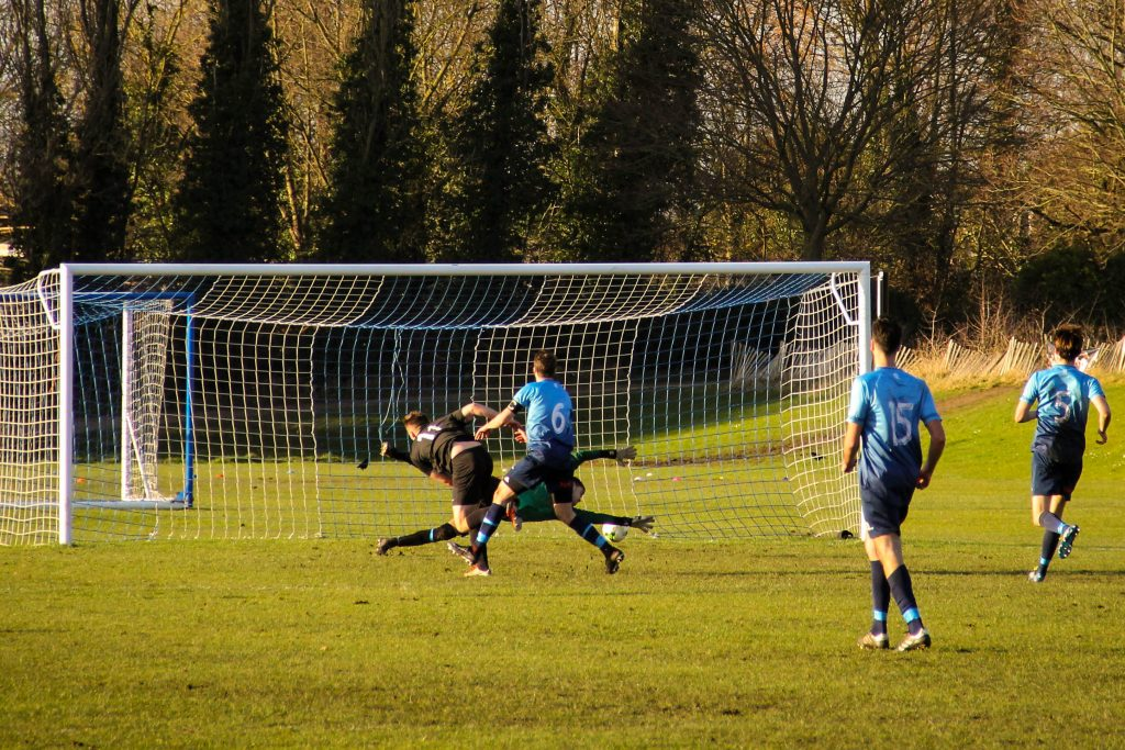 And then it is 3! Despite Greg Potts best attempts to putt him off, Lloyd grabs his goal. Photo: Louie Chandler