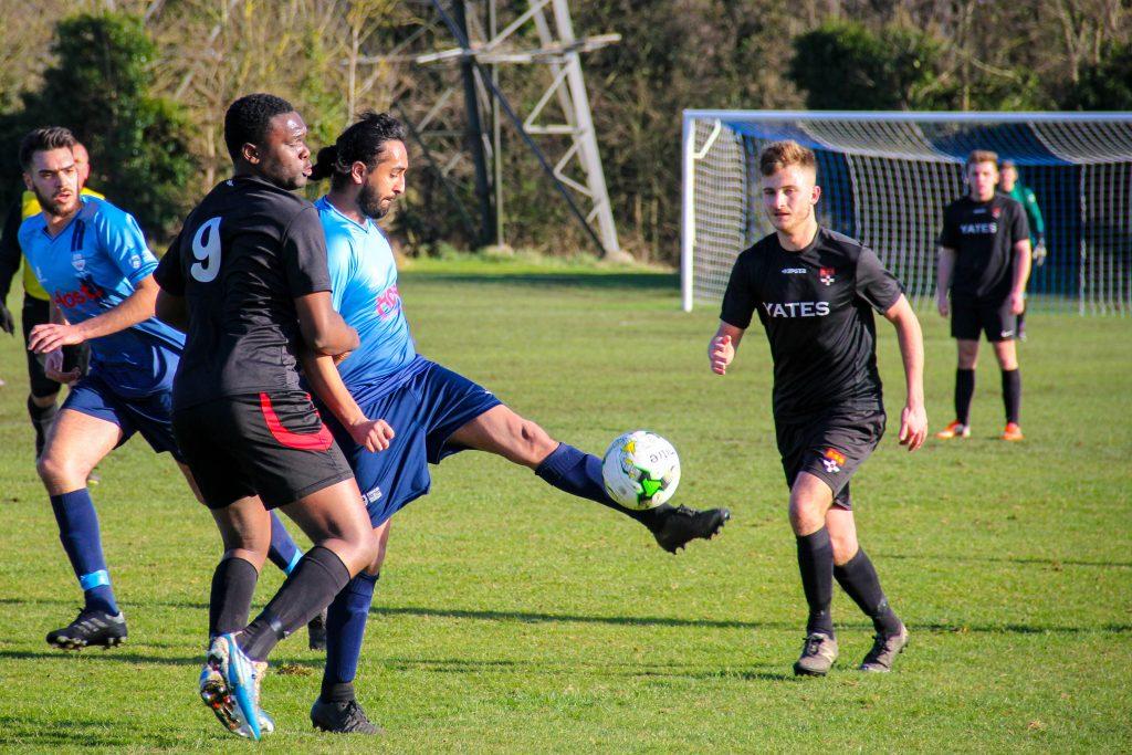Gurpz Tatla holds the ball up as Kingston attack. Photo: Louie Chandler