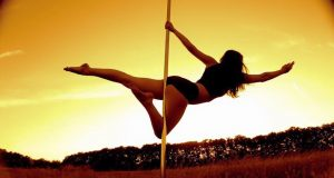 Stephanie Johnson poses on the pole in the sunset. Photo: Private / Stephanie Johnson