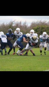 Defensive end Mackinnon makes a tackle- Photo: AMF facebook