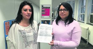 Sosa Moreno (left) and Sanchez Godenzi (right) with their petition. Photo: Hannah Roberts