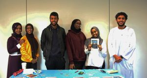 Members of the Somali Society promote their collection of hijabs and abayas to donate to Syrian women