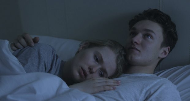 Parker (Harrrison Osterfield) and Rose (Vala Norén) laying in bed together