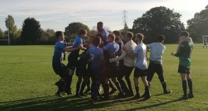 Kingston men's team celebrating their cup victory over Essex. Photo credit: Kiri Sathananthan