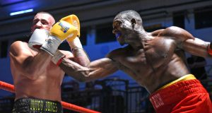 Richard Riakporhe on his way to victory on his professional debut against Jason Jones Photo: Rex Features