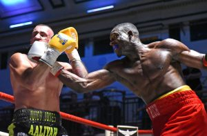 Former gang member and Kingston grad wins first pro boxing title