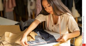 Mandatory Credit: Photo by REX/Shutterstock (9952681a) MODEL RELEASED Young fashion designer working in her studio VARIOUS