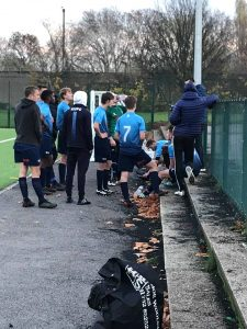 The Kingston team discussing tactics with Coach, Besim Ali at the end of regular time. Credit: Craig House