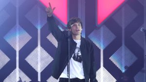 Louis Tomlinson shares his creative process and One Direction secrets