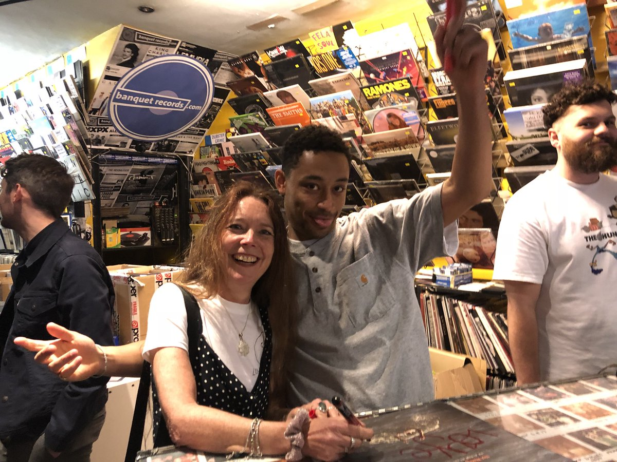 Two people pictured in a Kingston record store.