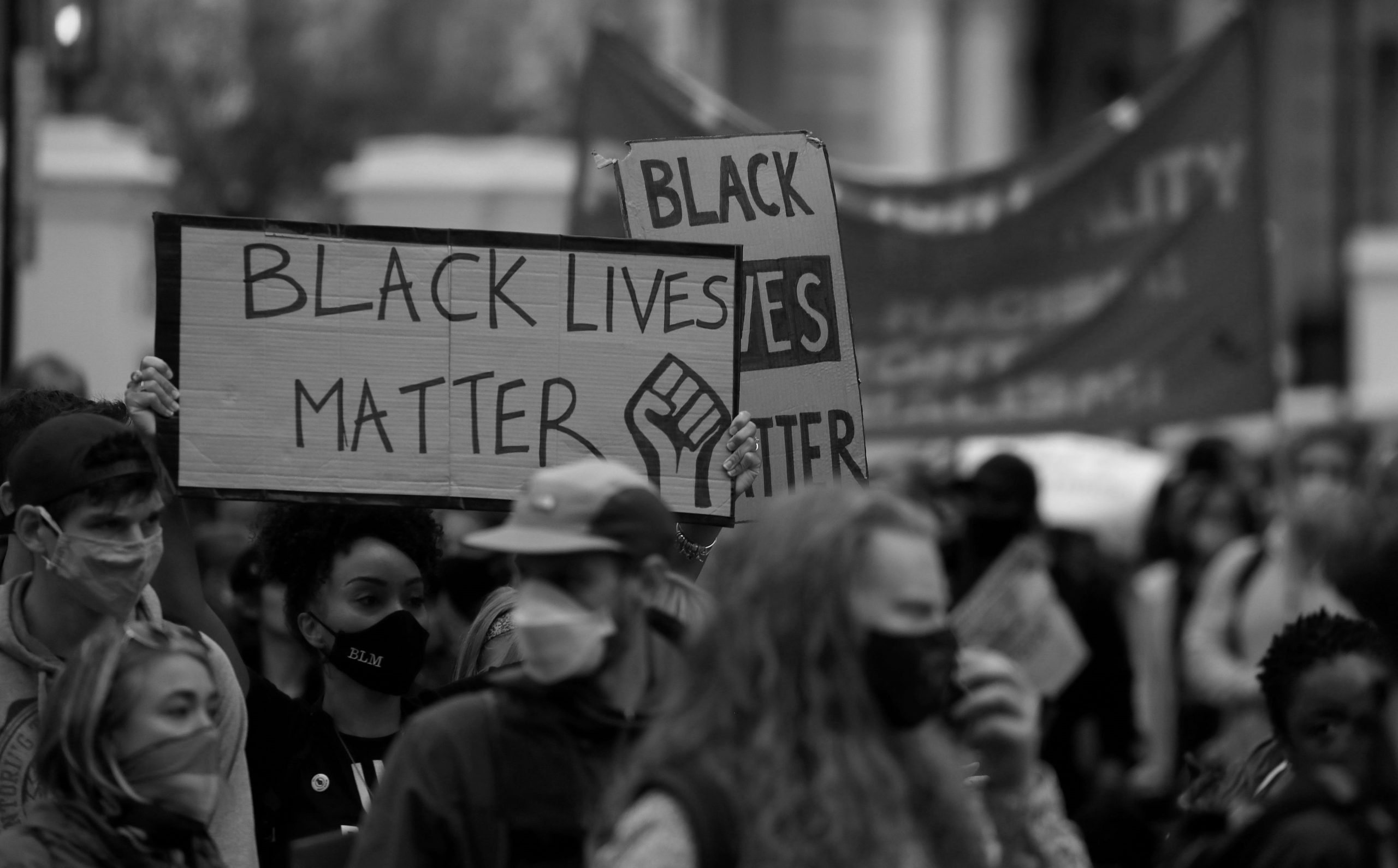 A protest for the BLM movement in London depicting signs.