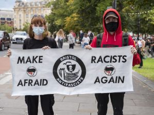 A sign protesting against racism.