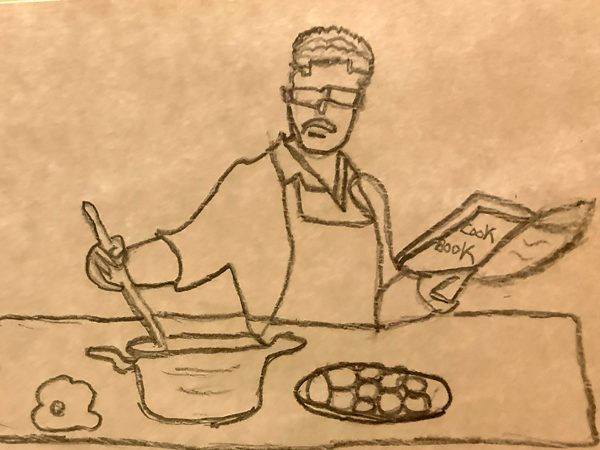 A man cooking while following the instructions from a cook book.