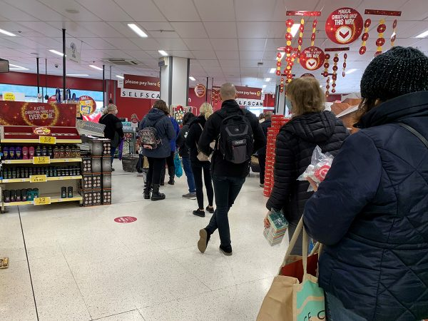 People are lining up to purchase their goods in Wilko