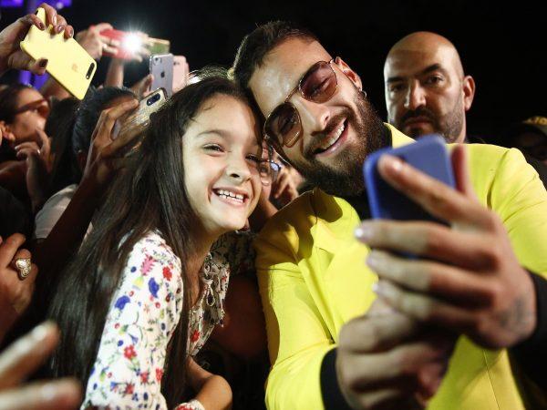 Maluma taking a selfie with a fan