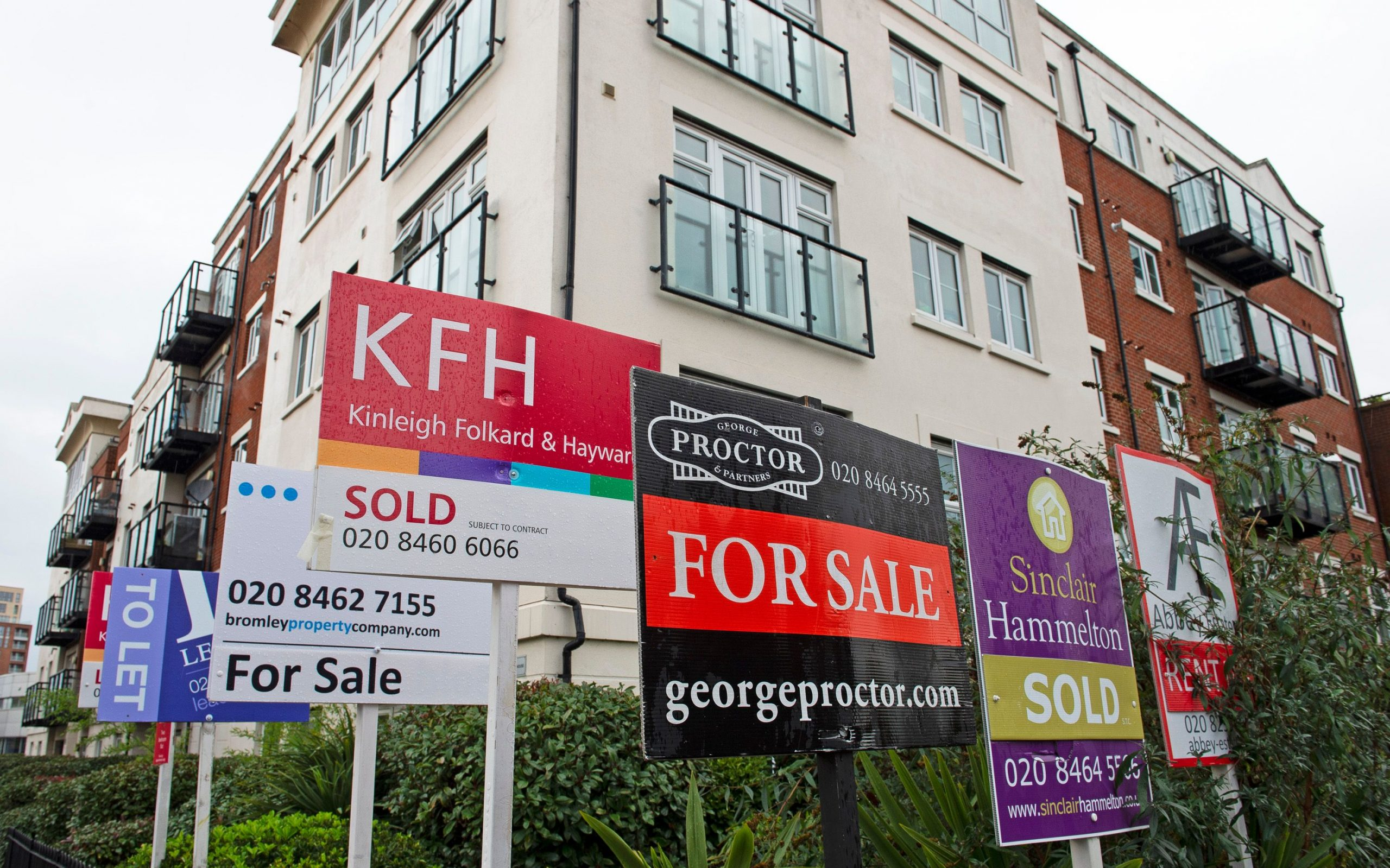an image of several estate agent signs outside a building