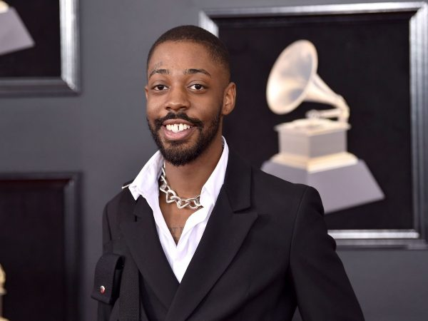 Brent Faiyaz posing with a big smile at the 60th annual Grammy Awards