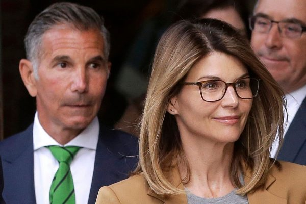 Actress Lori Loughlin, front, and her husband, clothing designer Mossimo Giannulli, part of the 2019's college admission scandal in the US