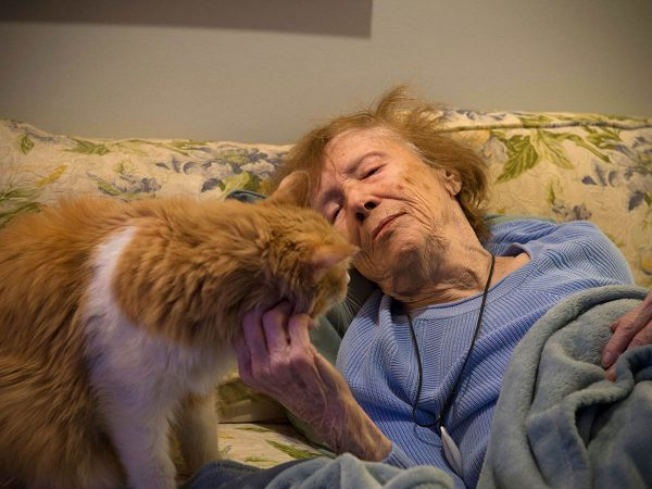 Image of an elder woman with her cat