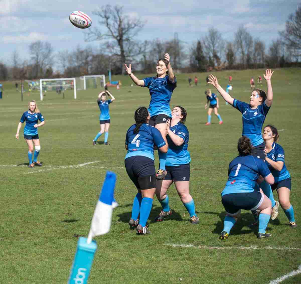 KU women's rugby perming a line-out