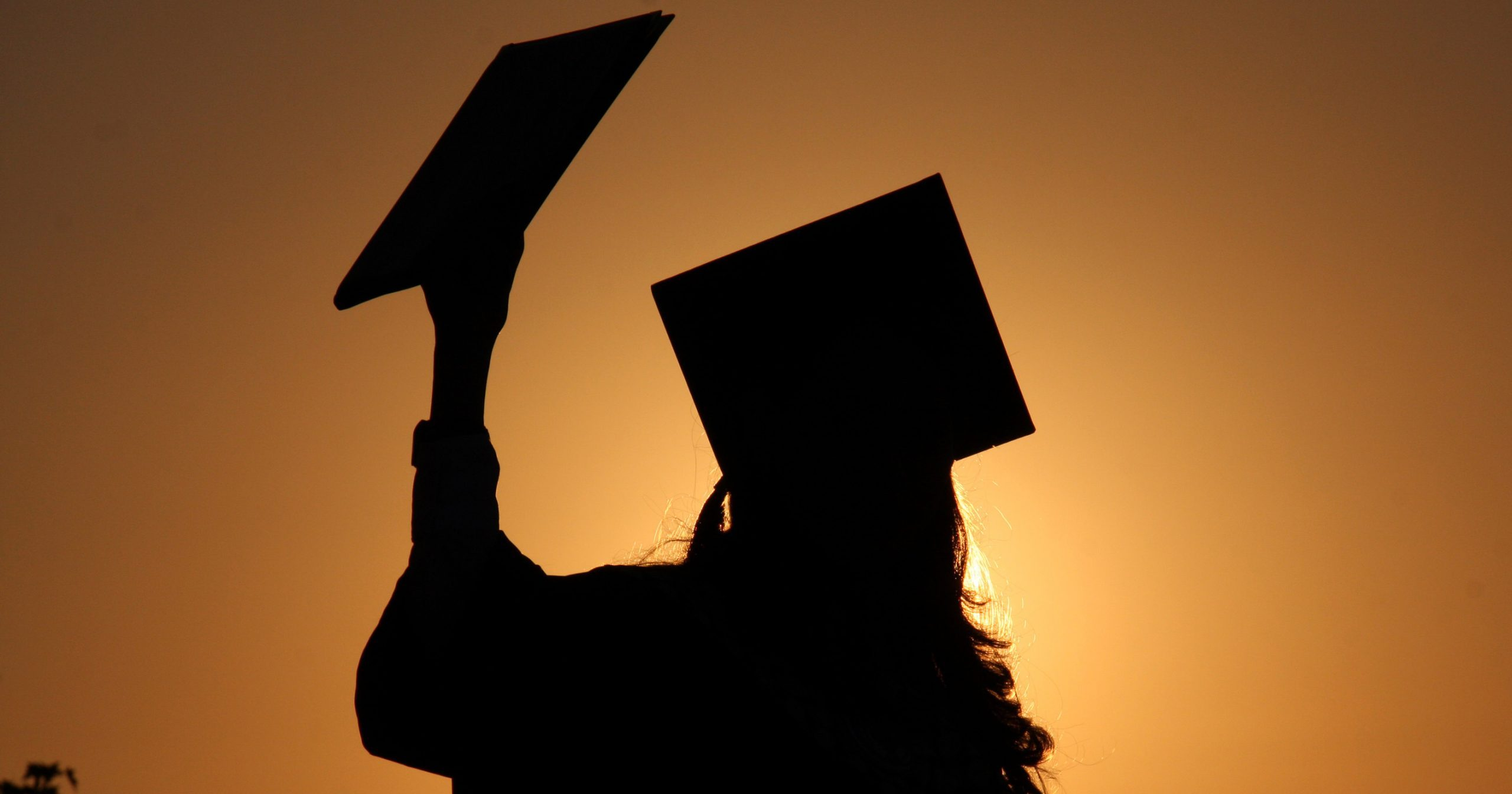 Silhouette of a university student graduating