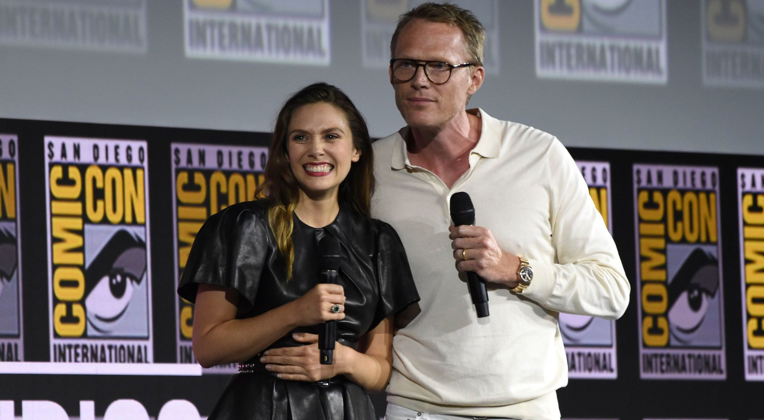 An image of Elizabeth Olsen on the left and Paul Bettany on the right at Comic-Con.