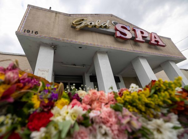 Image of a Spa in Atlanta, flowers left on the floor for the victims of the shooting