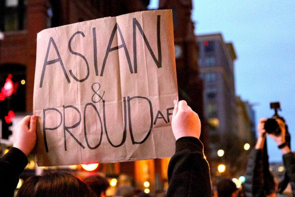 """""""Asian and proud"""" banner shown at a rally in solidarity with the recent Anti-Asian incidents in the US"""